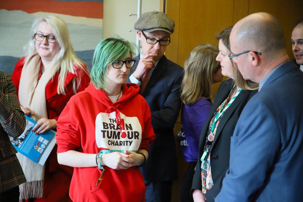 Hannah, a Young Ambassador with Brain Tumour Charity talks to Ian Levy MP and Cherilyn Mackrory MP
