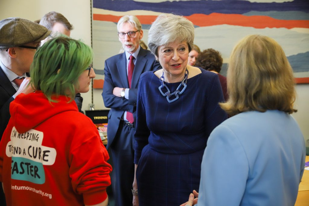 Theresa May talks with Hannah a Young Ambassador for Brain Tumour Charity and Jill Clark from Action Against Heartburn